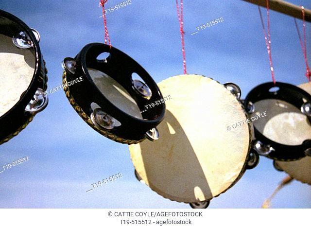 Tambourines hanging in a row