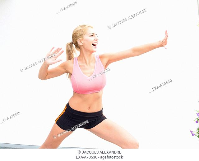 Woman practicing exercise indoors