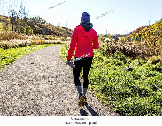 Young woman walking on track