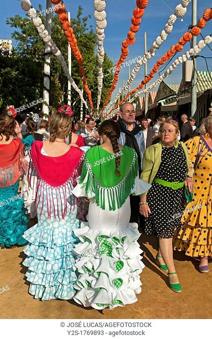 April Fair, Youngs women wearing a traditional flamenca dress, Seville, Spain