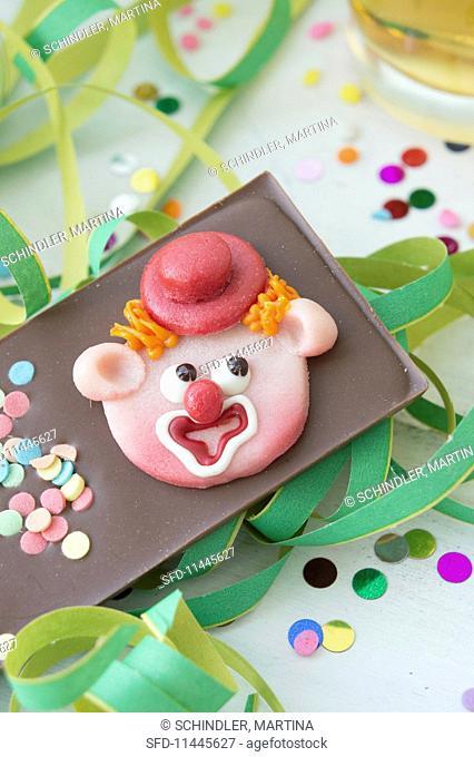 A chocolate slab with a marzipan clown face