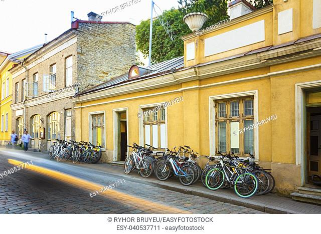 Tallinn, Estonia. Bicycles Rental Bikes Parking Near Old House In Old Part Town In Summer Evening. Bicycle Tourism