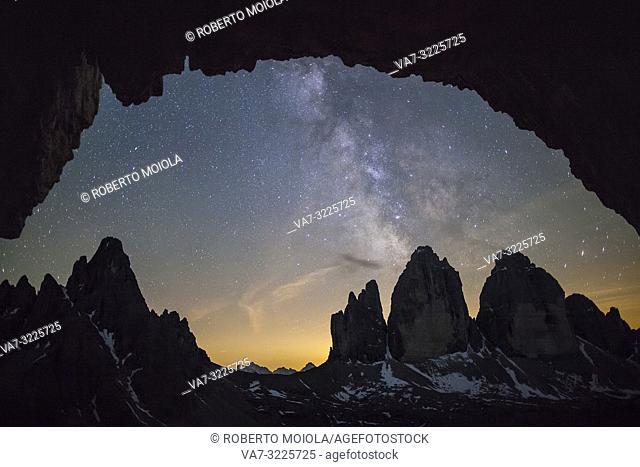 Milky way above the rocky peaks of Tre Cime di Lavaredo, Sesto Dolomites, Bolzano province, South Tyrol, Italy