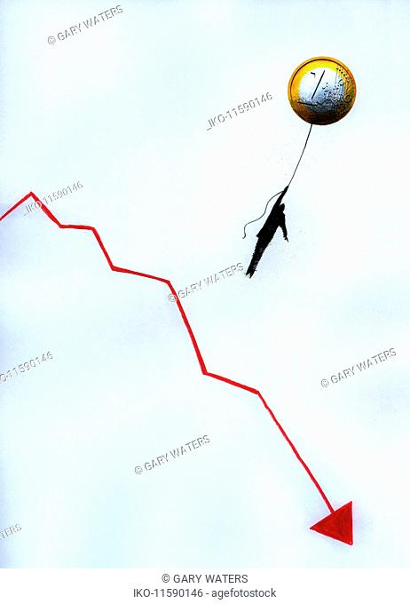 Businessman hanging from Euro coin balloon above descending line graph
