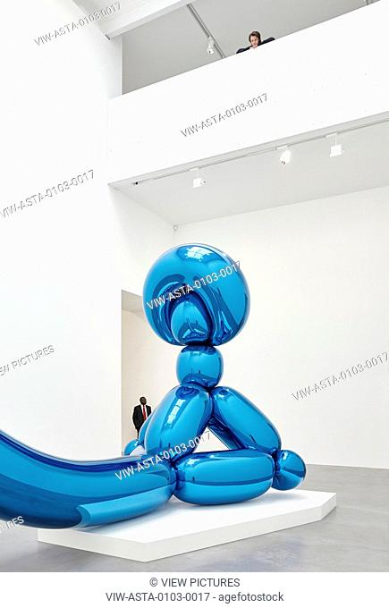 Jeff Koons Balloon Sculpture in the double height gallery space with person looking over. NEWPORT STREET GALLERY, London, United Kingdom