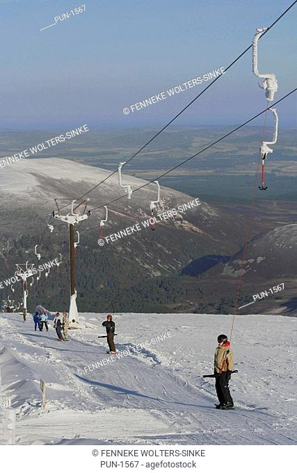 Skiers in lift at Cairngorm Mountain, Scotland