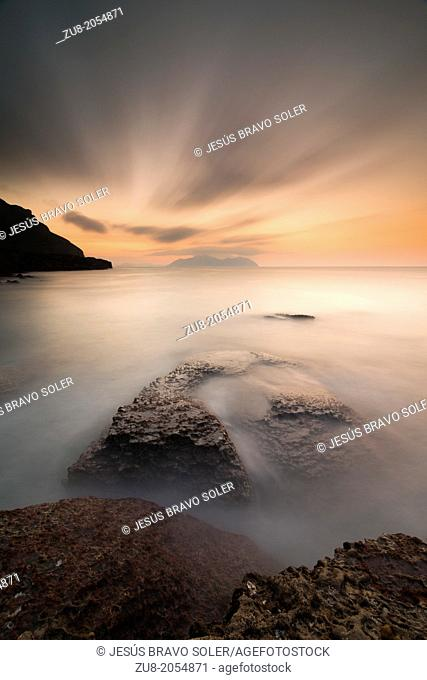 Sonabia in Cantabria Coast, the long exposure creates a confluence in the clouds and silky sea