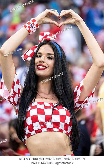 A cute Croatian fan shapes a heart, female, woman, fan, fans, spectator, trailer, supporter, half figure, half figure, portrait, gesture, gesture