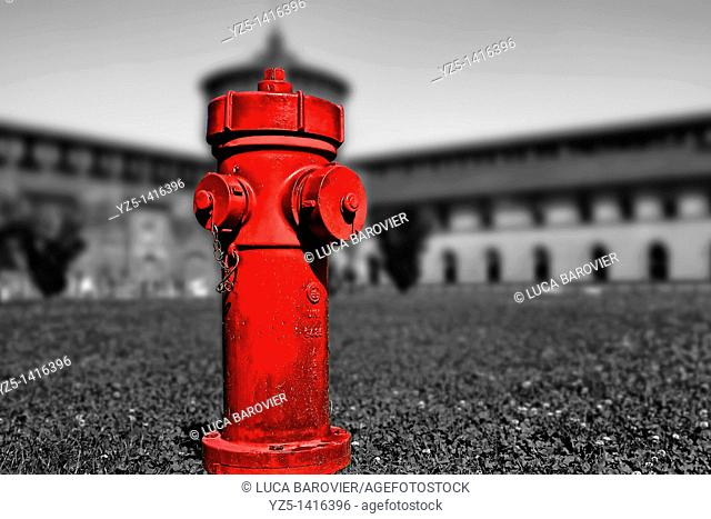 Red in castle, a standpipe in the garden of Castello Sforzesco, Milano, Italy