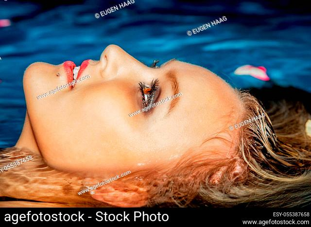 Head of a woman in water