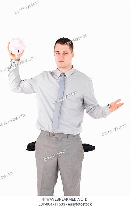 Portrait of a broke businessman with empty pockets