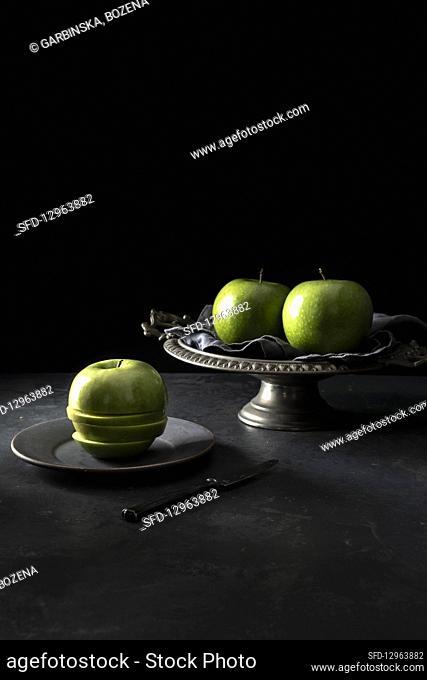 Three green Granny Smith apples