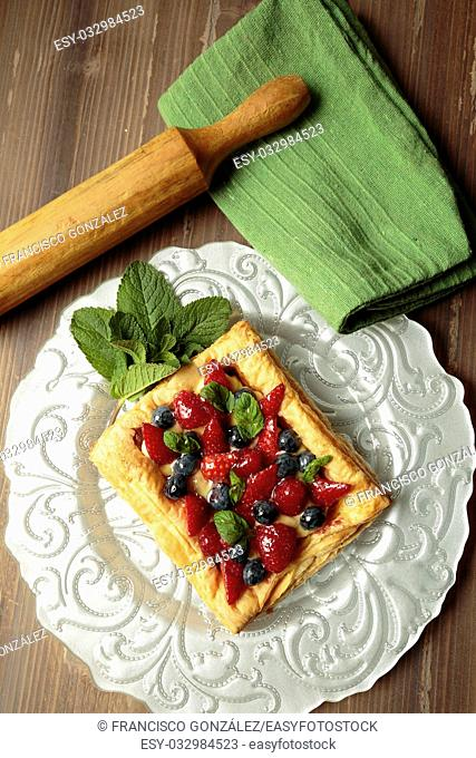 puff pastry pie with fruit on a plate of silver