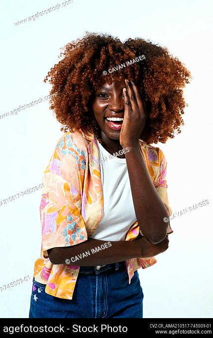 Happy afro woman posing over white background