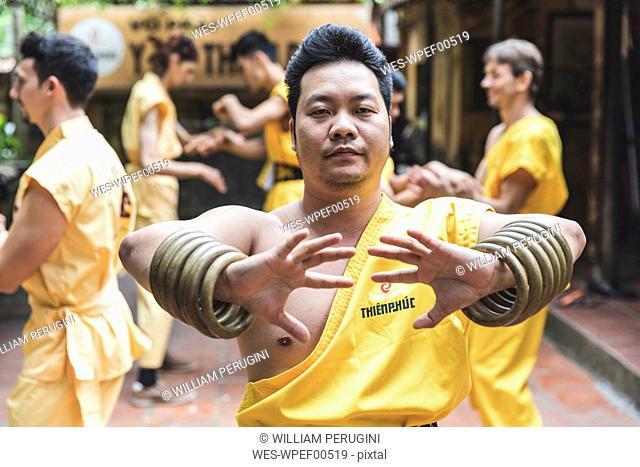 Vietnam, Hanoi, men exercising kung fu