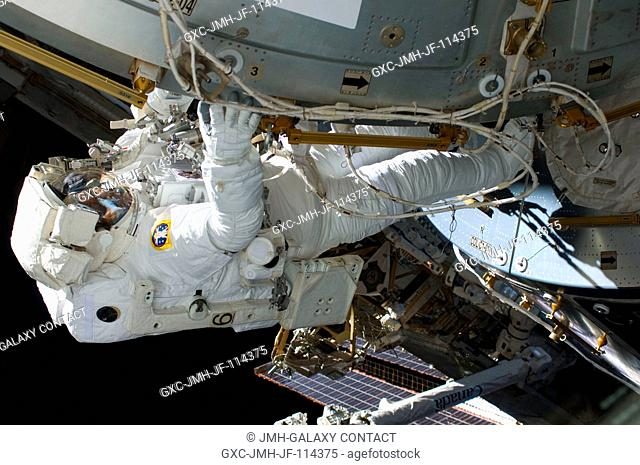 Astronaut Robert L. Satcher Jr., STS-129 mission specialist, participates in the mission's third and final session of extravehicular activity (EVA) as...