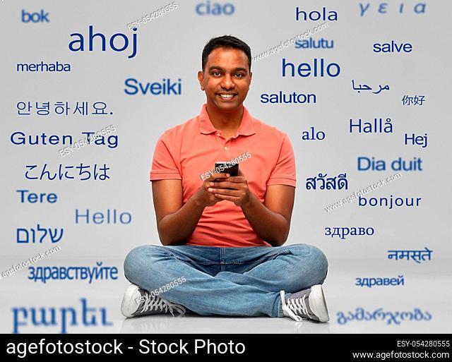 happy indian man using smartphone