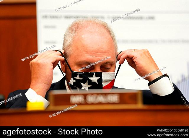 United States House Minority Whip Steve Scalise (Republican of Louisiana) adjusts his protective face mask at the start of a House Select Subcommittee on the...