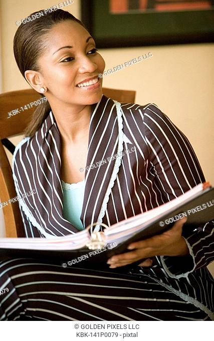 Businesswoman sitting inside office