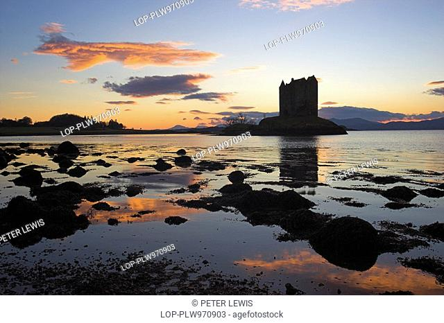 Scotland, Argyll and Bute, Port Appin, Sunset behind Castle Stalker, one of the best-preserved medieval tower-houses surviving in western Scotland