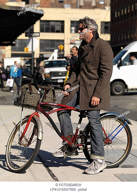 Adult man on a bicycle in Manhattan, New York City, U.S.A