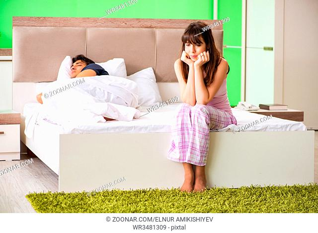 Woman and man in the bedroom after conflict