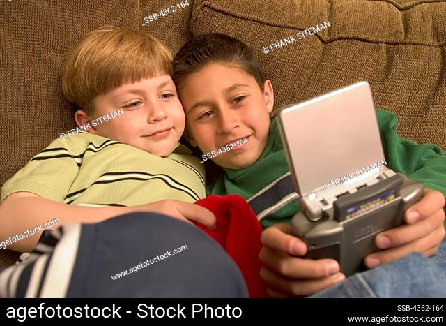 Brothers Playing Video Game