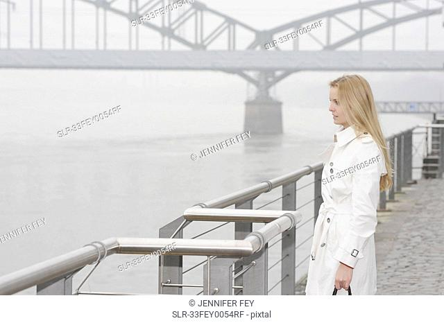 Woman overlooking city river