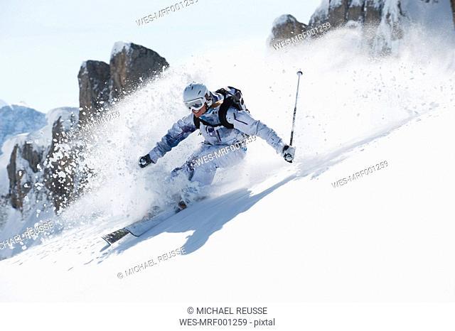 Austria, Kleinwalsertal, Young woman skiing