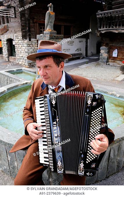 Switzerland, Valais, Val d'Herens, village of Evolene, summer festival CIME (Célébrations Interculturelles de la Montagne, local accordion player
