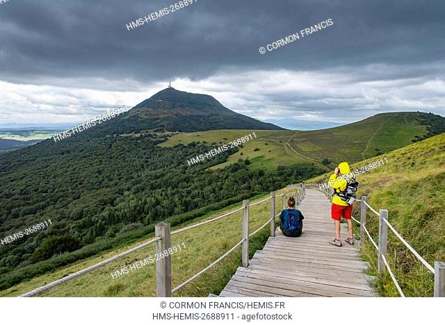 France, Auvergne, Puy de Dome, Regional Natural Park of Auvergne Volcanoes, Chaine des Puys, Orcines, wooden steps for access to the top of the volcanic cone of...