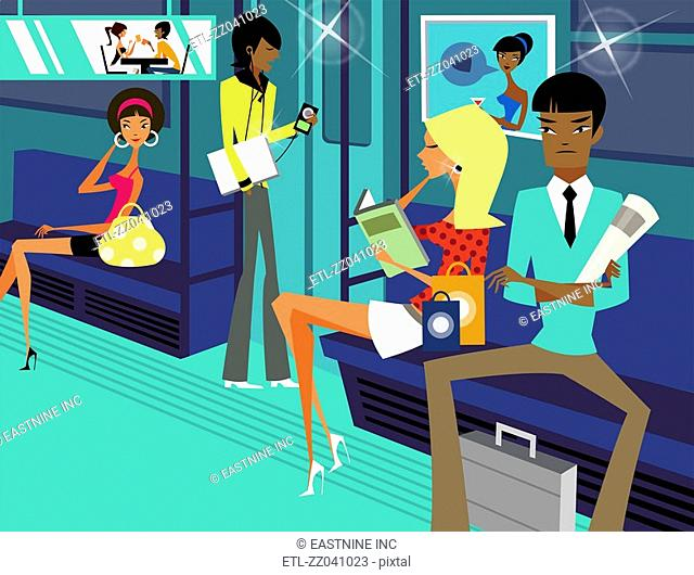 Four people traveling in a subway train