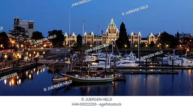 Victoria harbour and illuminated parliament at twilight in Victoria, Vancouver Island , Canada, North America