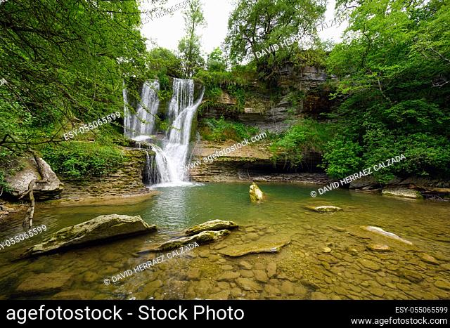 Idyllic rain forest waterfall, stream flowing in the lush green forest. High quality image