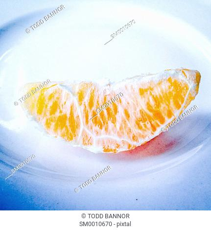 Orange section on plate