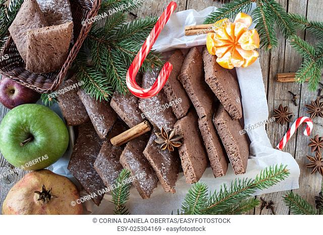 Christmas background with cookies, candy cane, fruits and spices. Top view shot
