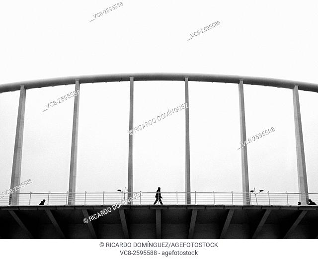 Man walking on Exposicio bridge made by Santiago Calatrava, Valencia, Spain