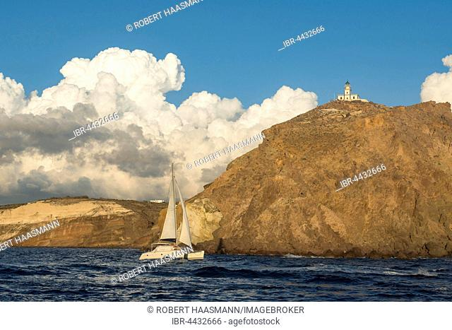 Sailboat passing lighthouse, Akrotiri, Santorini, Cyclades, Greece