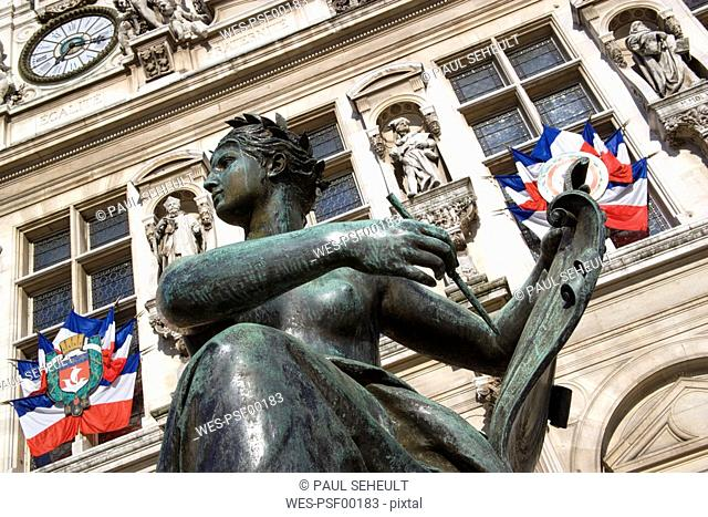France, Paris, Town Hall, statue in foreground, low angle view