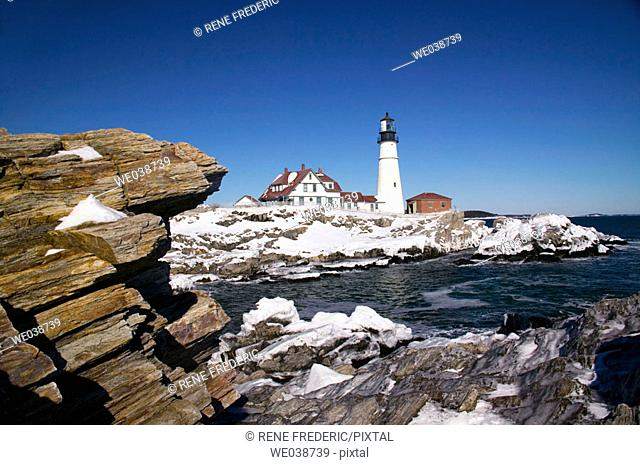 Portland Head Lighthouse with winter snow and ice in January, Portland, Maine, USA