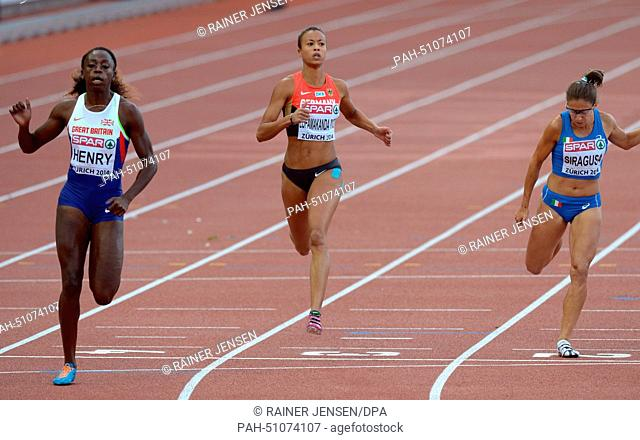 Desiree Henry (L) of Great Britain, Tatjana Lofamakanda Pinto (C) of Germany and Irene Siragusa of Italy compete in the women's 100m semifinal at the European...