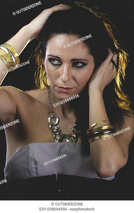 Gold, woman with Venetian mask metal, sad and pensive