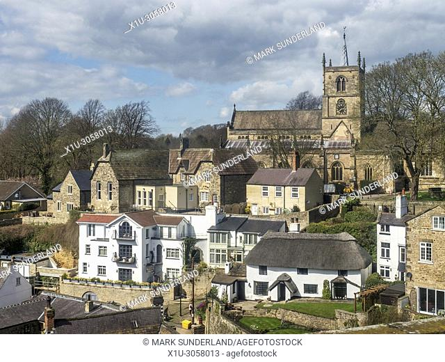 St Johns Church and Church Hall and the thatched Manor Cottage on Waterside at Knaresborough North Yorkshire England