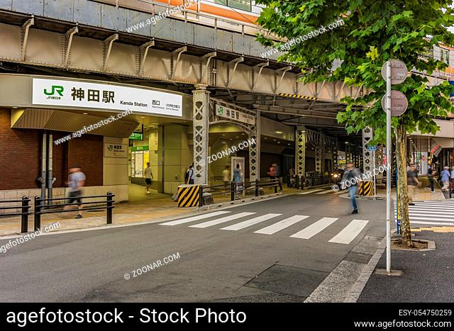 Underpass with metal pillar of the west entrance of Kanda Station on the Yamanote Line. The street extends over 300 meters and has no less than 100 shops
