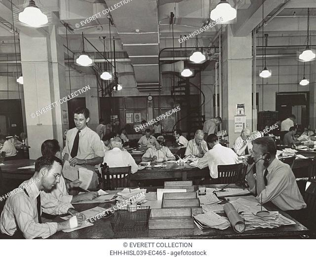 News room of the New York Times, Sept. 3, 1942. In the foreground is the City Desk which handles local news. The City copy desk is in middle ground