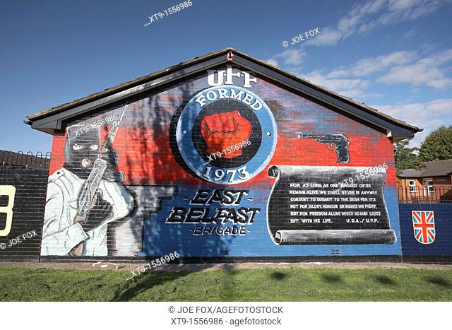 Loyalist terriorist wall mural, newtownards road, Belfast, Northern Ireland, UK  This mural depicts an armed masked UFF gunman  The Ulster Freedom Fighters was...