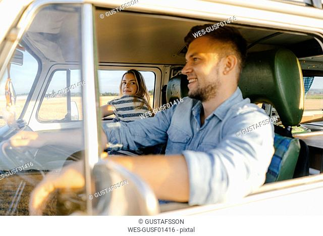 Young couple on a trip in camper van