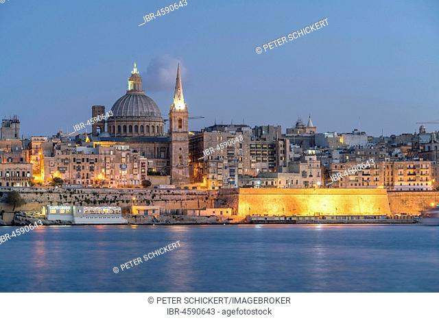 City view with St. Paul's Pro Cathedral and Carmelite Church at dusk, Valetta, Malta
