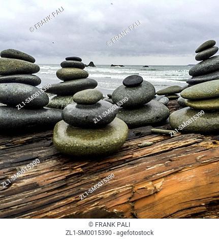 Rock Stacks on log by the ocean Ruby Beach, Olympic Peninsula, Washington USA 47°42'40' N 124°24'57' W