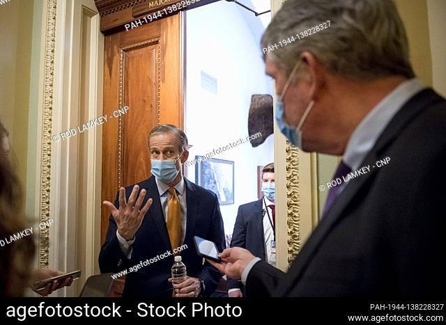 United States Senator John Thune (Republican of South Dakota) talks to reporters outside his office at the US Capitol in Washington, DC, Wednesday, December 16